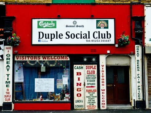 I set off to walk from the far end of Bond St where a colorful Social club seemed to be doing alright with it's welcoming signs and open door