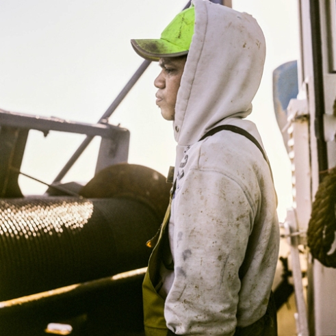 Eddie crewman of the Keila, a trawler from Westray. Trawler life can be tough, harsh weather conditions, little sleep, monotonous routines and banality. The crew are often out for ten days or more.