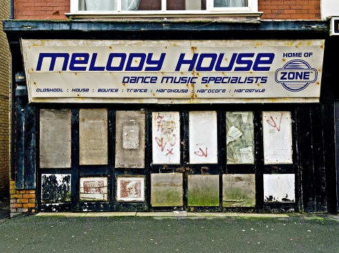 A relic from the past. Melody House was first on Lytham Rd near the old Lido swimming pool then moved to Bond St years ago then moved again to Bolton St…it has been closed for donkeys years but if you were lucky sometime ago and it was open you would find a guy sat in among boxes and boxes of vinyl..scattered, broken, stacked to the rafters..vinyl everywhere like a dream, I once asked if he had an album I'd been looking for, he assured me he had and if I had the time he'd find it for me, sadly I didn't have the time but am sure if I'd stayed he would have found it..I left him looking very happy reading his NME, Mojo and Q magazines sat in the middle of a collector's dream.