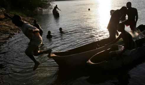 Local fisherman return to shore with their catch on a small river near Mambone, Mozambique. (2005)