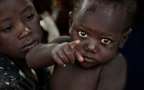 A young boy in a small village heavily affected by the AIDS virus near Mambone, Mozambique. (2005)