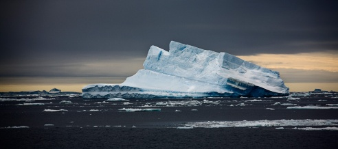Iceberg With Yellow Sky Antarctic February 2010