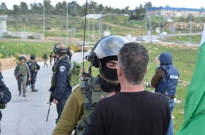 """Nabi-Saleh Argument: A heated argument erupted at the regular protest in Nabi-Saleh, West Bank. The Israeli soldier demanded the protester leave the area and became aggressive when told """"he would not leave""""."""