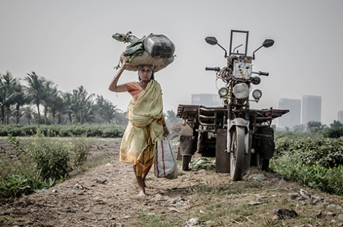 A women returning home from work. Calcutta, India.