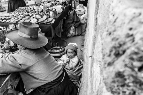 Child at market stall