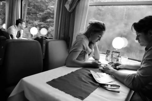 A couple in the dining car on train between Prague and Berlin