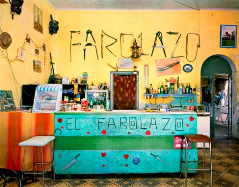 """El Farolazo This is a bar whose clients are mostly people that work on the farms, hence the name on the wall written with farm tools. The word farolazo means """"big lamp,"""" and it refers to the bottom of a glass of whisky seen through the light. It looks like a lamp or, in Spanish, a farol. Coronel Vidal, Buenos Aires Province 2006"""