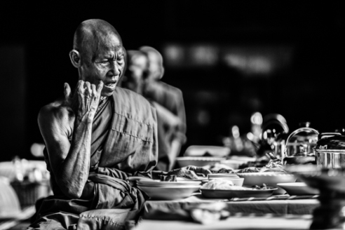A monk has his final meal of the day after prayers Rural Cambodia
