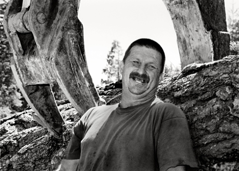 Robert Ambrosini - is a loader operator. He has just told the story of how he lost his front teeth. The story involved too much beer and flying fists. Western Sierra Nevada near Calaveras County 2004