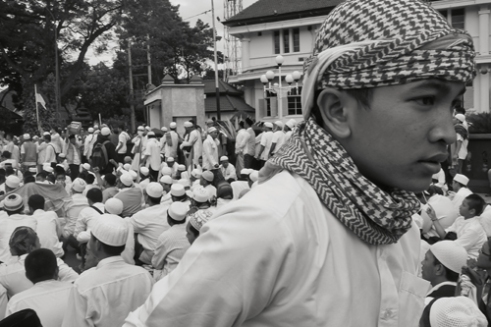 Young protester following a anti blasphemy demonstration. Hundreds of Muslims went to the Mayor's office in Malang, East Java. Indonesia 2016