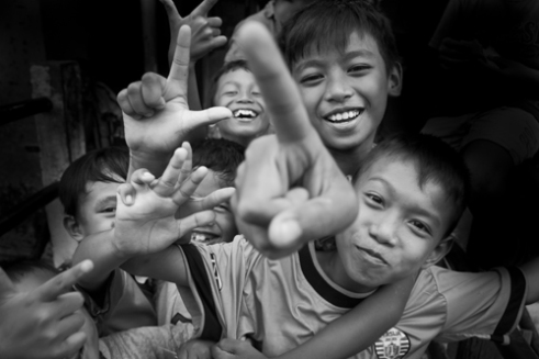 Children being children as they play and laugh These kids were evicted from their homes, in the densely populated slum of Tanah Abang by their local government. Jakarta. Indonesia 2014