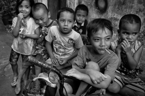 There's a limited amount of land designated for children activities in Jatinegar. These children are playing in a narrow alley. East Jakarta, Indonesia