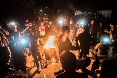 "Souda Refugee Camp, Chios - Greece. | After a group of Algerians attacked a group of Afghans and the Afghans scared them away, they made a campfire in front of the police and danced around it ""To show that we are a peaceful people"" ."