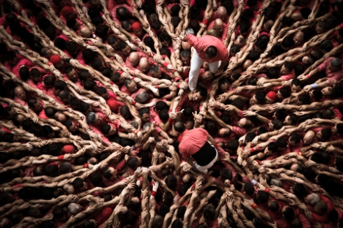 Colla Vella Xiquets de Valls prepare the base of their next human tower during the XXV Concurs de Castells in Tarragona