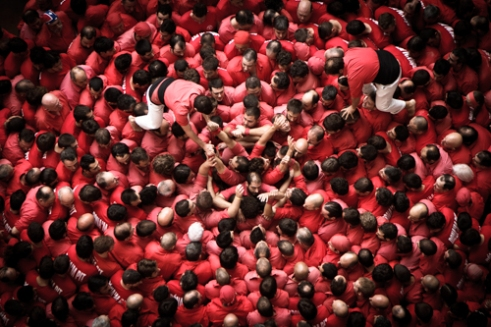 Colla Joves Xiquets de Valls prepare the base of their next human tower during the XXV Concurs de Castells in Tarragona