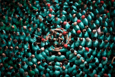 Castellers de Vilafranca prepare the base of their next human tower during the XXV Concurs de Castells in Tarragona,