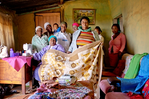 "Khuthalani Support Group, KwaNyuswa, Valley of 1000 Hills, KwaZulu-Natal The 15 members of Khuthalani Support Group run a bakery, raise poultry, tend a vegetable garden and sew items such as bedspreads for sale. Their energetic achievements led to the group being awarded Gogo Support Group of the Year in 2015 by the Hillcrest AIDS Centre Trust. It costs R20 to become a member of the group; and R10 monthly subscription, which is put into a bank savings account and used when needed. A committee coordinates the group and consults the members on decisions, and one member takes minutes. ""I don't know what I would do without the support and help from the group. Each of us has lost family members and we comfort each other. If someone loses a young child, we all help that person to buy groceries. Also, our sewing and bread-making businesses mean we can feed our families and save. When we can't pay for something, we offer clothing alterations to people in exchange – we did this with the meeting house we are building which has helped a lot,"" says Bongekile Phewa, one of the Support Group members."