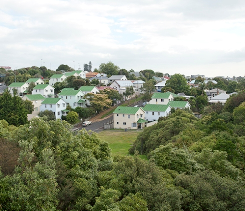 A typical neighborhood in Auckland. It is common for backpackers to save up money in Australia and spend them travelling to New Zealand. New Zealand itself is part of the Working Holiday Visa Program.