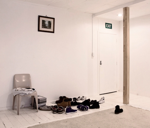 The entrance of a house shared by backpackers. Most of the backpackers on a Working Holiday Visa shares houses and accommodations in general, it helps to save money and it encourages social meetings. Auckland. New Zealand