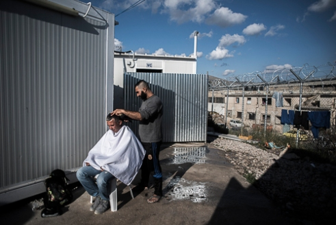 "VIAL Refugee Detention Center Chios - Greece | Hairdresser from Syria doing his job ""I don't want food or clothes, i want a life""."