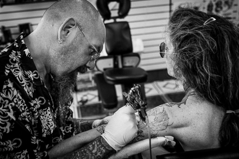 """""""Issy"""" was busy all week making magic with ink on skin. He is one of the most sought after tatto artists who travels to Sturgis each year."""