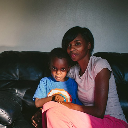 "East Chicago, Indiana Stephanie King embraces her youngest son, Josiah King, 3, whose blood lead levels test results were above the CDCís 5 mg/d threshold for action. Two and a half years ago, King left Chicago's South Side to find a safer environment for her four sons and one daughter. ìIf Iíd have known the dirt had lead, he wouldnít have been out there playing in it,"" King said. 