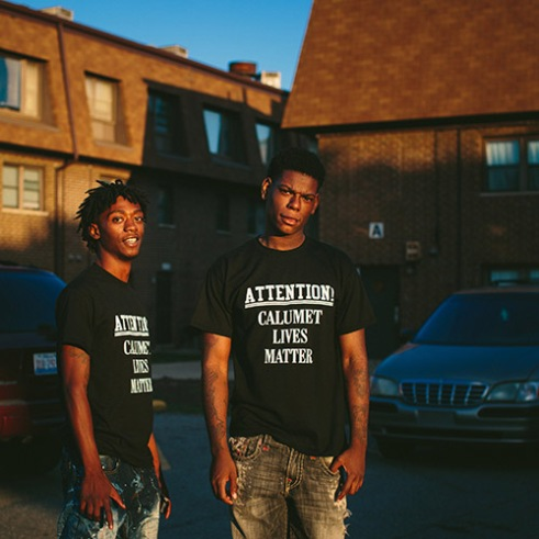 "East Chicago, Indiana 18-year-old brothers Antwon Jones, at left, and D. Jones pose for a portrait near their home in the West Calumet Housing Complex. ""This is where we hang out every day. We are still here with the lead,"" D. Jones said. Though city officials learned the extent of lead and arsenic levels in the soil in late May, very few residents have moved out as of the first week of October. Many say it has been hard to find an equivalent home in the area."