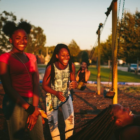"East Chicago, Indiana From left, friends since childhood, Janae Peyton, 13, Ashanti France, 12, Irene Wooley, 13, and Tniyah Foxx, 12, swing at the park near the West Calumet Housing Complex in East Chicago, Indiana. The playground is part of the Carrie Gosch Elementary School, which has been turned into an EPA office. ""All my memories are here. I've got to move away from my friends,"" Peyton said. 