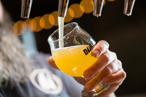 Saturday October 22, 2016 - Ryan Trask, with Durty Bull Brewing Company, in Durham, NC, pours a Sour Blonde Ale at the taproom in Durham, North Carolina.