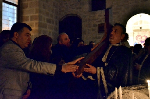 Holy Thursday commemorates the arrest and prosecution of Jesus and is enacted with rituals. Dressed in black, the priest walks around the darkened church with a cross he carries on his shoulder. This represents the crucifixion of Jesus. Members of the congregation touch the cross and pray.