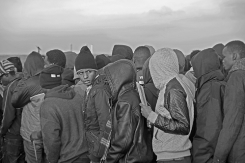 Another face in the crowd Refugees line up during the 'evacuation' of the Jungle, Calais. There were estimated to have been more than 7,000 people living in the Jungle at the time of the 'evacuation'.