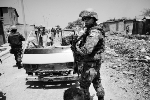 A squad of Brazilian UN Peacekeepers patrols Cité Soleil