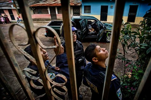 "A man lies dead in his truck after being shot along with his family, by 2 hitmen in a neighborhood of Tegucigalpa, Honduras. January 8, 2015. Gangs in this country require citizens to pay a ""war tax"", mandatory money that gives them the right to work without being killed; the man in this photograph had the courage to refuse to follow the guidelines of corruption in their society and decided to hold on to his values of transparency that resulted with his death. To believe in the possibility of a general change, it is necessary to start with small individual changes, this belief and determination to fight for a better future leaves an orphan daughter and a widow wife. He wanted to start a change... At a country as Honduras, that has the dubious honor of being the most violent country in the world, having the highest per capita murder rate in the planet: 600 homicides in a month, 20 deaths in a day, more than 7000 in a year… where everything is corruption: government, police, society and a place where gangs rule the laws… ordinary people are the only ones who can fight against the corrupt establishment trying to build a better life for the next generation."