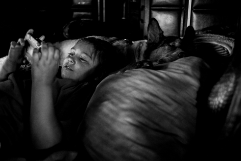 The Morrison's 8-year-old daughter Zelda spends some alone time in the rig's sleeper.
